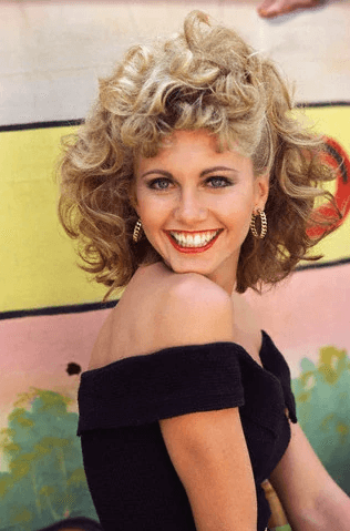 Olivia Newton-John as Sandy Olsson in Grease