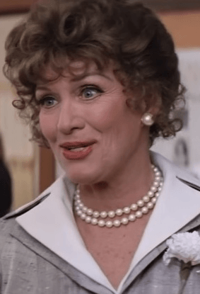 Eve Arden as Principal McGee in Grease