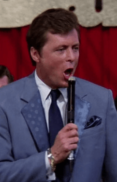 Edd Byrnes as Vince Fontaine in Grease