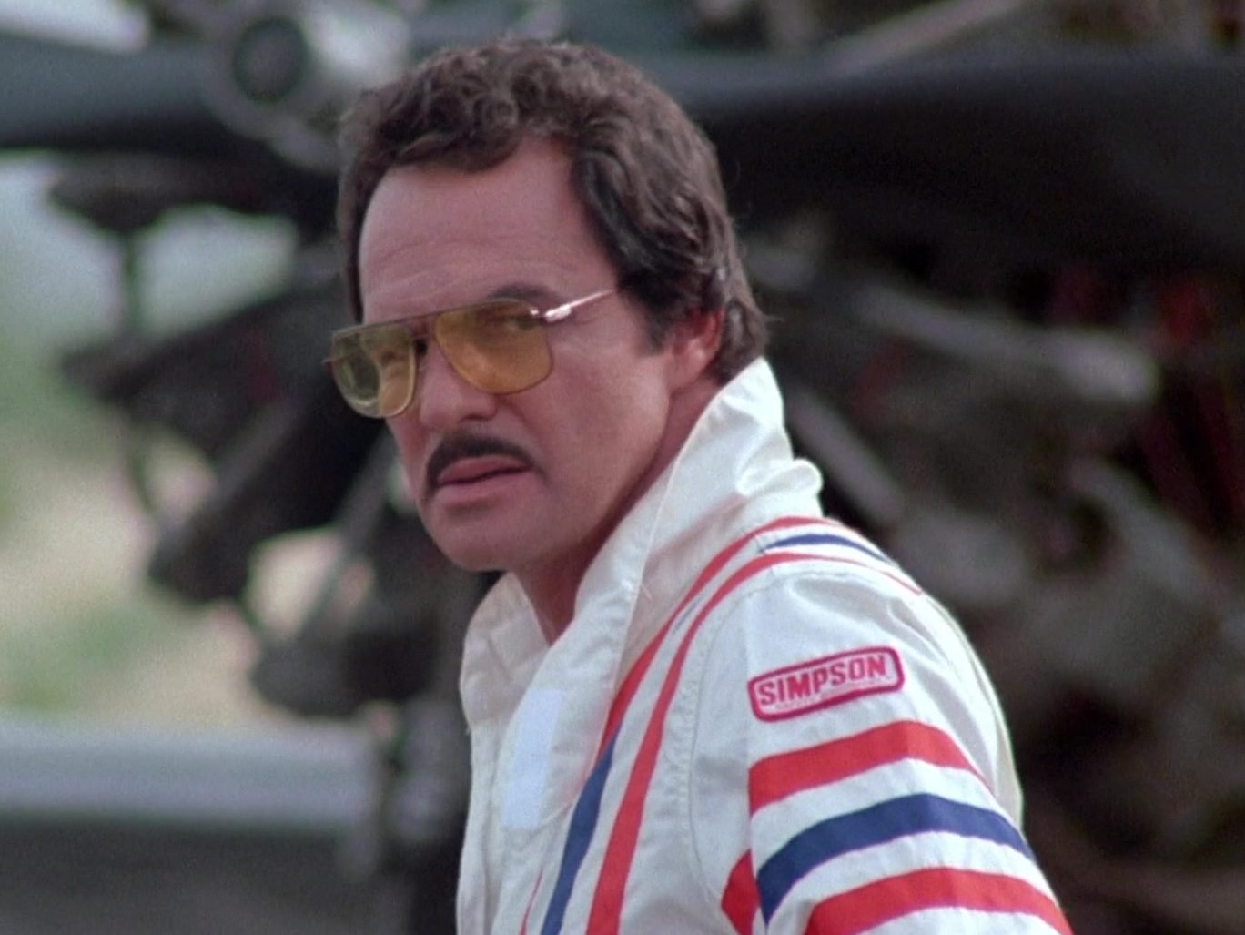 Simpson Racing Suit of Burt Reynolds as J.J. McClure in Cannonball Run II 1 e1627036026381 20 Fun Facts You Didn't Know About The Cannonball Run Films