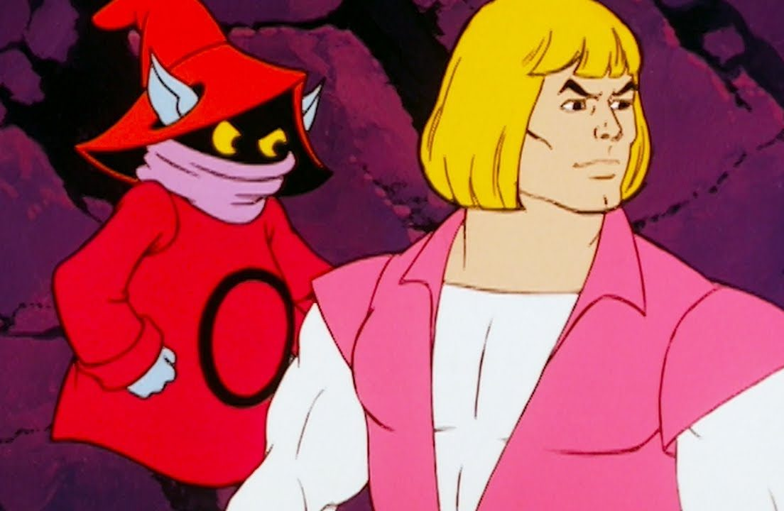 Orko, annoyed, looks at He-Man
