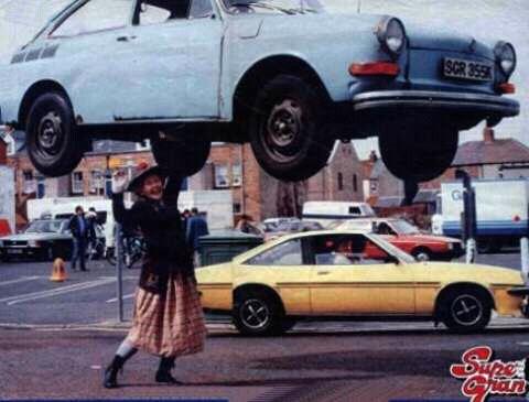 Super Gran lifting a car
