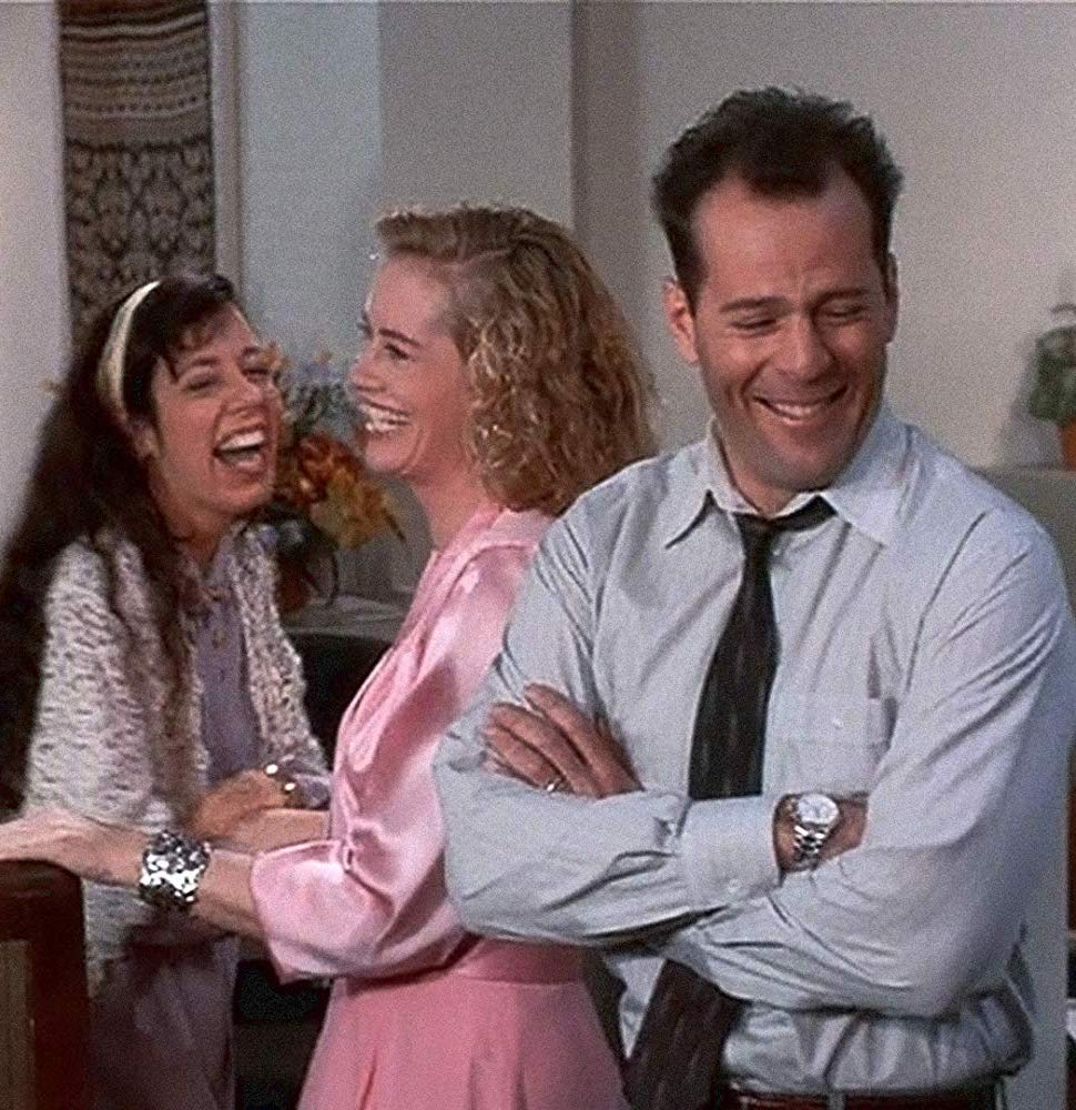 Bruce Willis and Cybill Shepherd laughing on the set of Moonlighting
