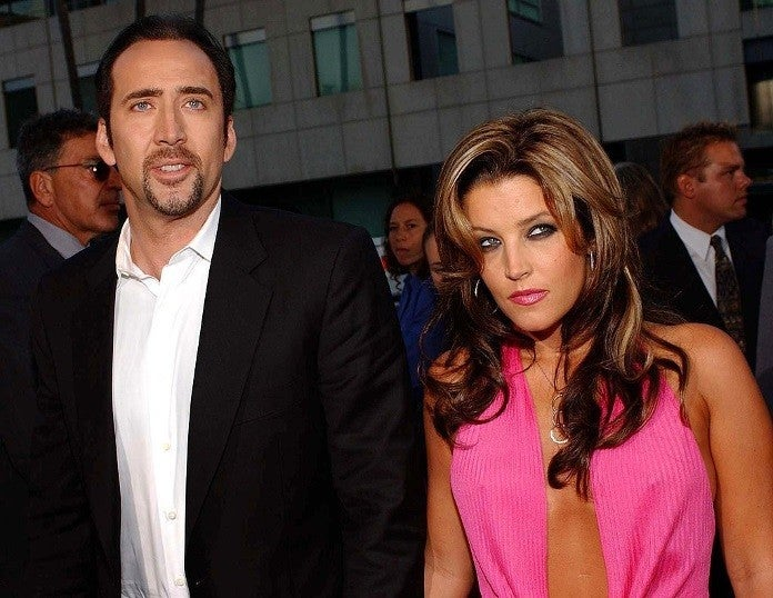 lisa marie presley nicolas cage getty images 20063749 20 Fascinating Facts You Didn't Know About Nicolas Cage