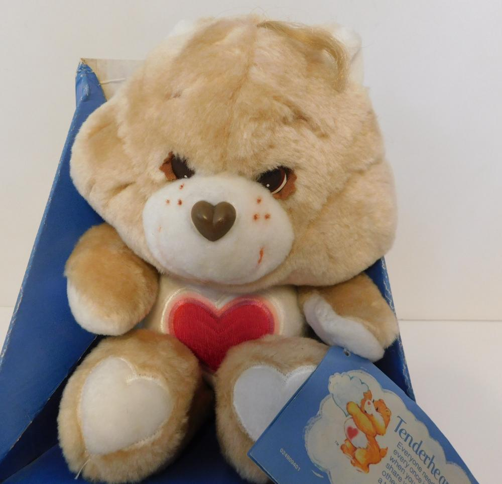 The beige Tenderheart Care Bear, complete with red heart