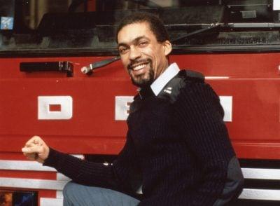 Recall Mackenzie next to a fire engine