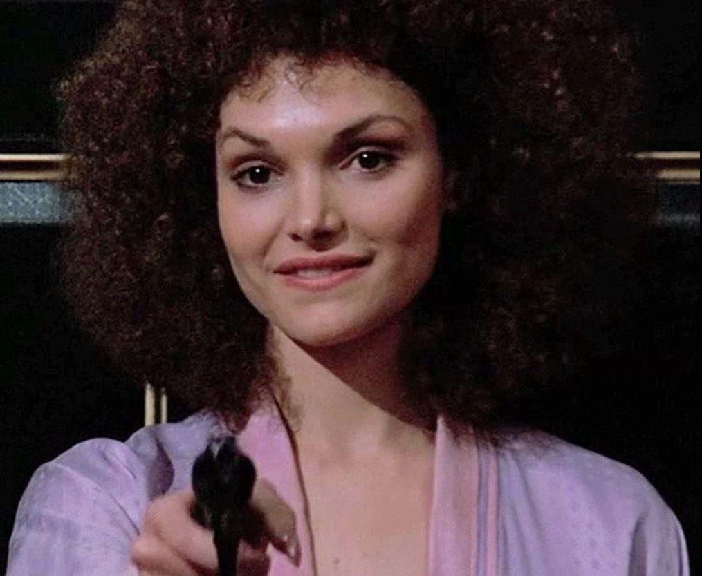 Mary Elizabeth Mastrantonio as Gina Montana (Tony's sister) in Scarface, distributed by Universal Pictures
