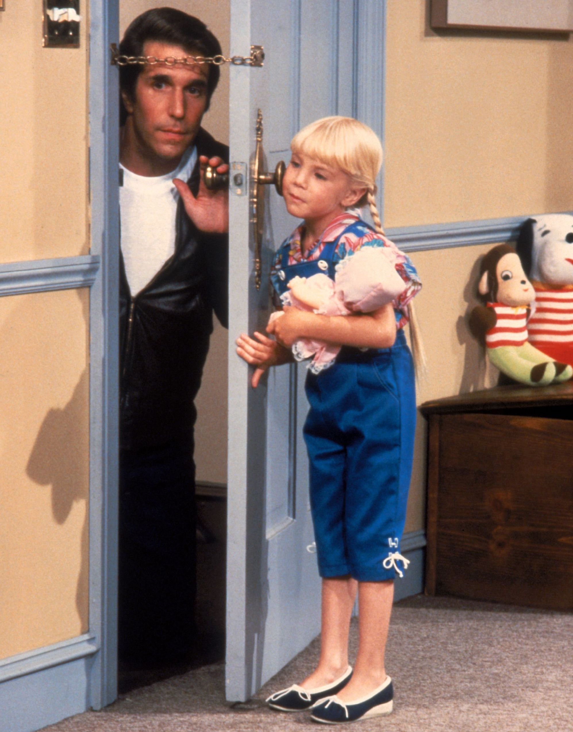 Heather O'Rourke as Heather Pfister in Happy Days 1982