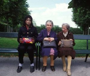 Rare Celebrity Photos 59 Michael Jackson with two old ladies on a park bench 20 Rare Celebrity Photos You've Never Seen