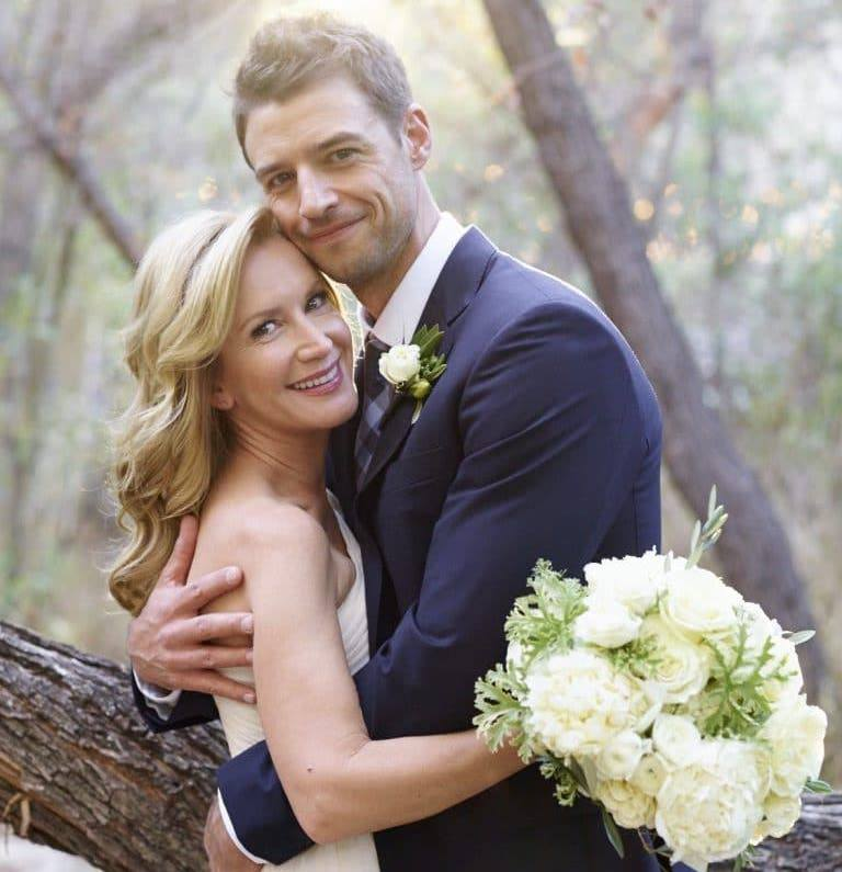 Angela Kinsey and husband Joshua Snyder on their wedding day, 2016 (bouquet included)