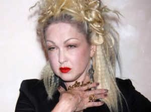 Cyndi Lauper with crimped hair and red lipstick