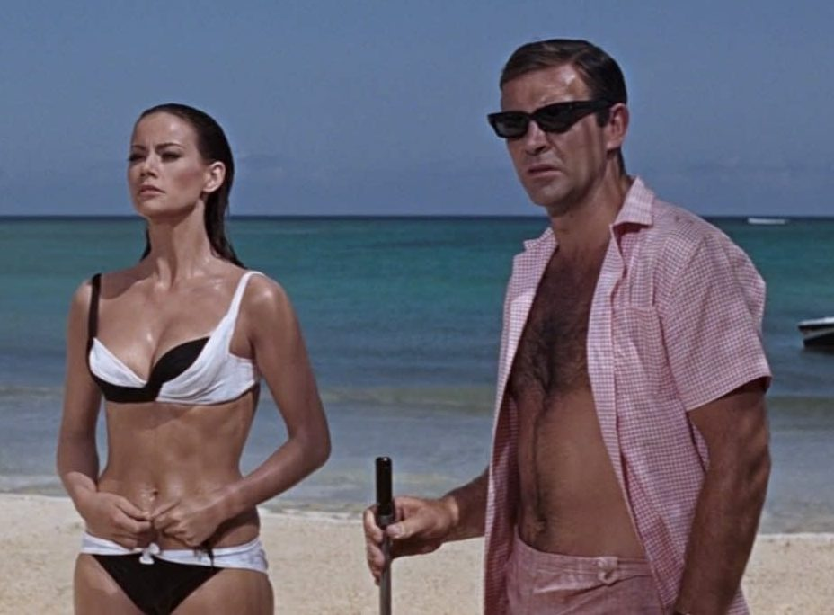Bond Domino on the beach e1615306052116 20 Facts About GoldenEye Even A Secret Satellite Couldn't Uncover!