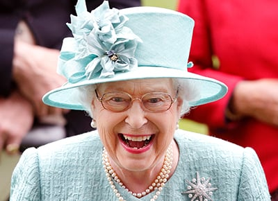 Queen Elizabeth laughing.c 10 Things You Didn't Know About The Crown