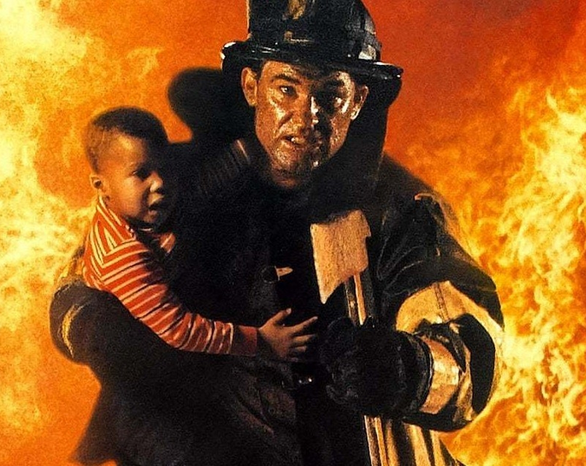 stephen mccaffrey carrying a child from the fire