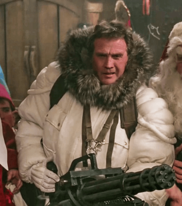 Lee Majors poses with a Minigun in Scrooged