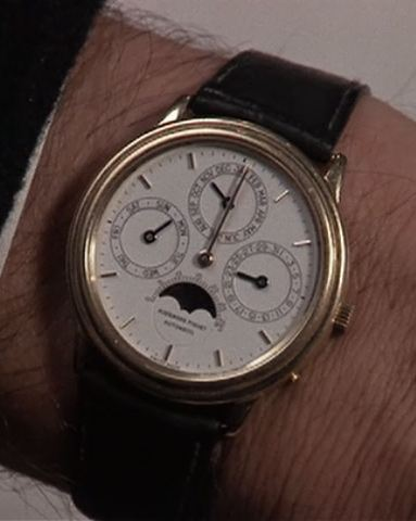 A wrist watch tells the wrong time in Scrooged