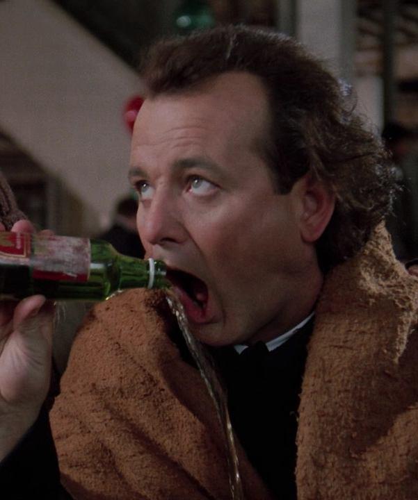 Bill Murray drinking beer as Frank Cross in Scrooged