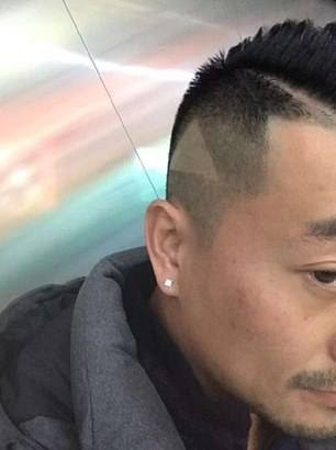 1546870985 869 Barber cuts triangle into the man39s hair after he takes him a photo with the amp 39 play amp 39 showed Barber Cuts 'Play' Icon Into Man's Hair After Customer Showed Him Paused Image Of Model