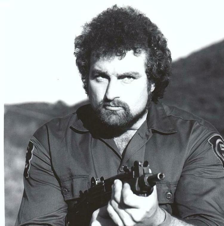 John Matuszak with a gun