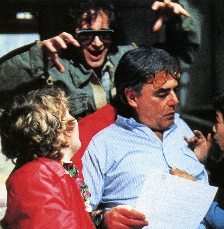 Steven Spielberg spooking director Richard Donner on the set of The Goonies