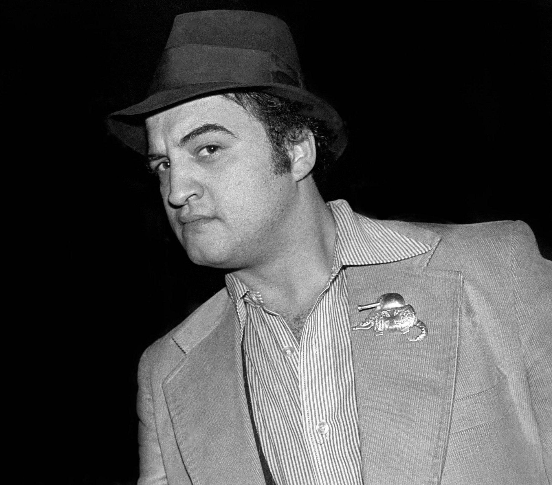 https www.biography.com .image MTY0MjAwMzk1OTQwMzA4MDk3 john belushi portrait of john belushi photo by richard e aaronredferns scaled e1608207941937 20 Things You May Have Missed In Ghostbusters