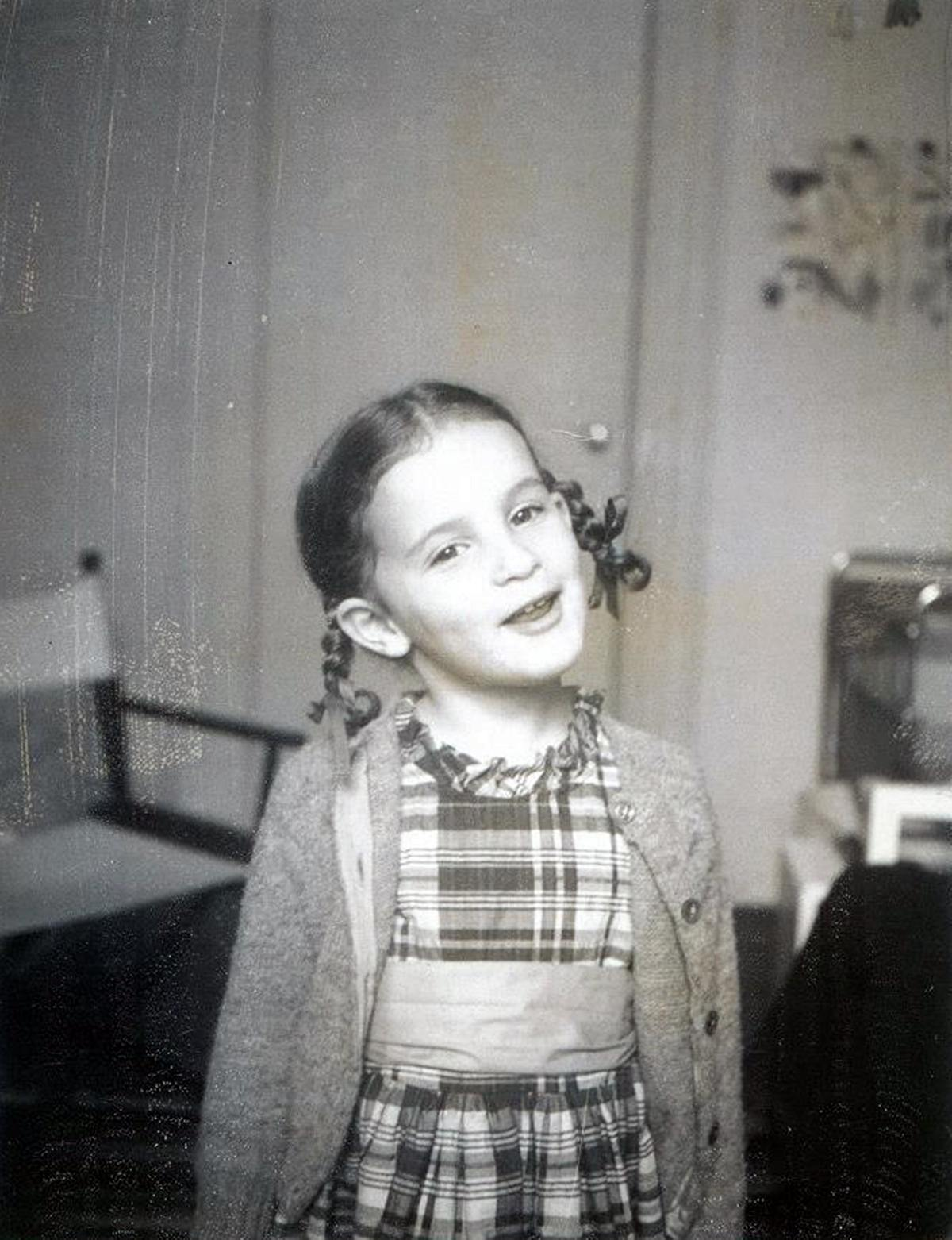 A home photo of a young Jennifer Grey, with pigtails