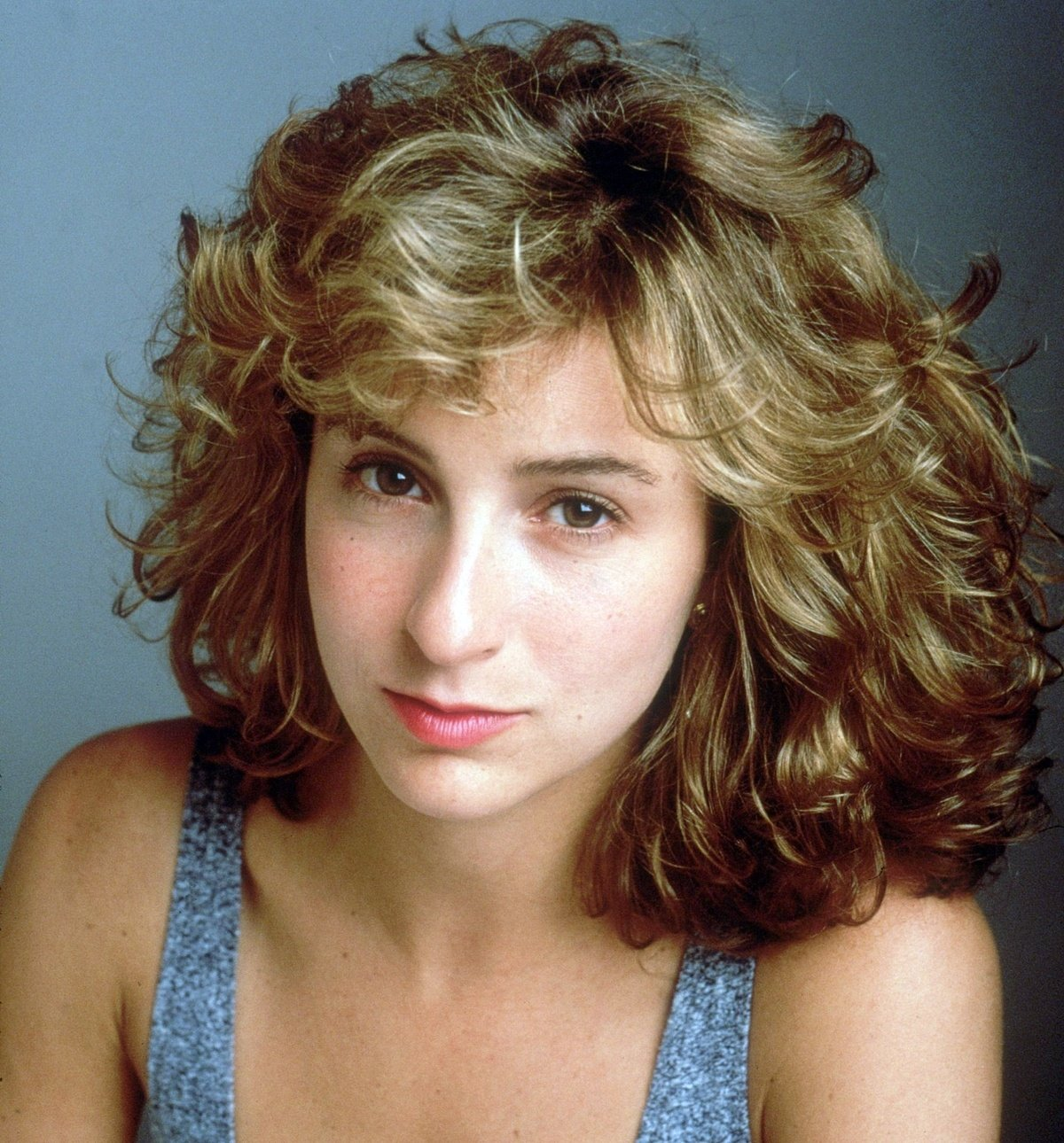 Jennifer Grey in the 1980s, complete with a perm