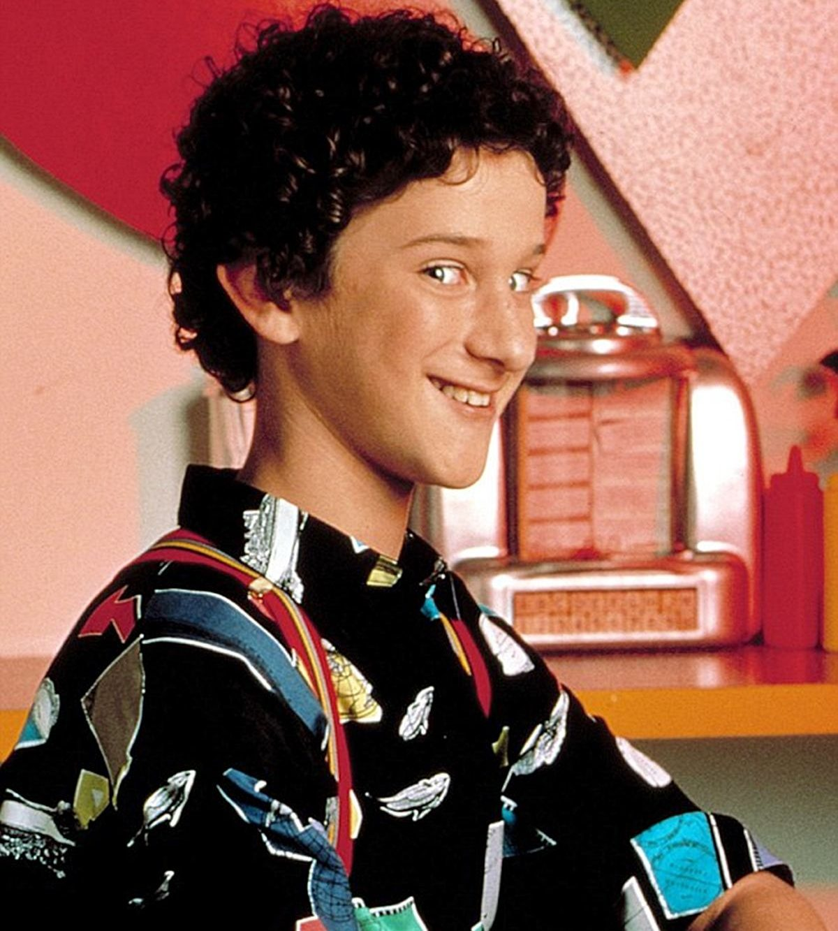 Dustin Diamond smiling as Screech in Saved by the Bell