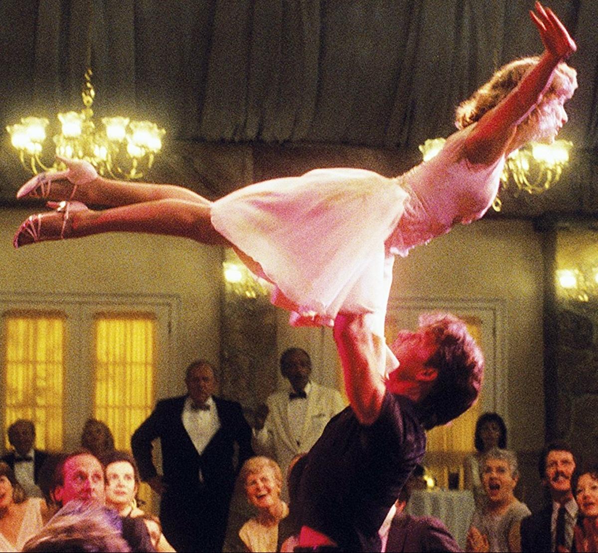 Patrick Swayze, as Johnny Castle, lifts Jennifer Grey as Baby Houseman in Dirty Dancing, 1987
