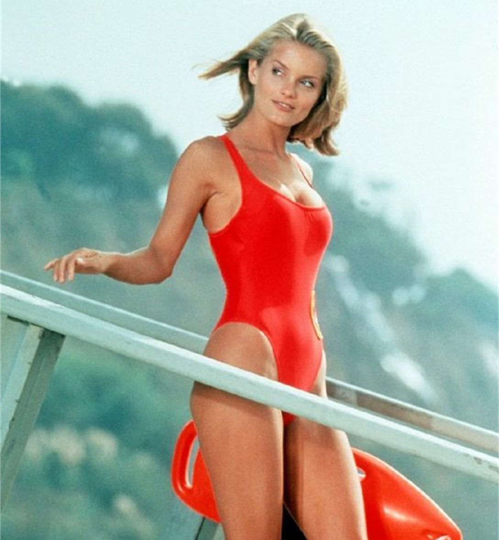 Kelly Packard as April Giminski in Baywatch swimsuit