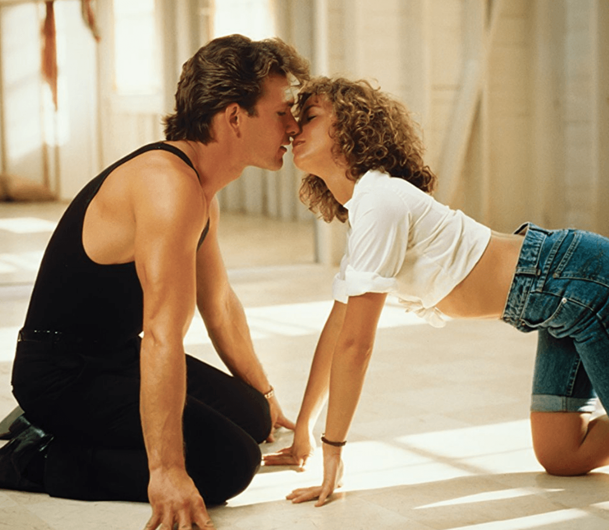 Jennifer Grey and Patrick Swayze share a kiss as Baby and Johnny in Dirty Dancing