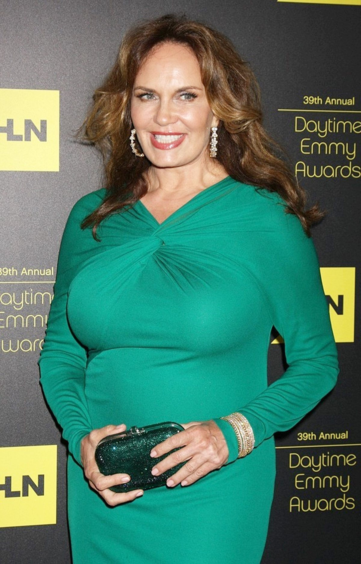 Catherine Bach wearing a green dress to the 39th Daytime Emmy Awards in 2012