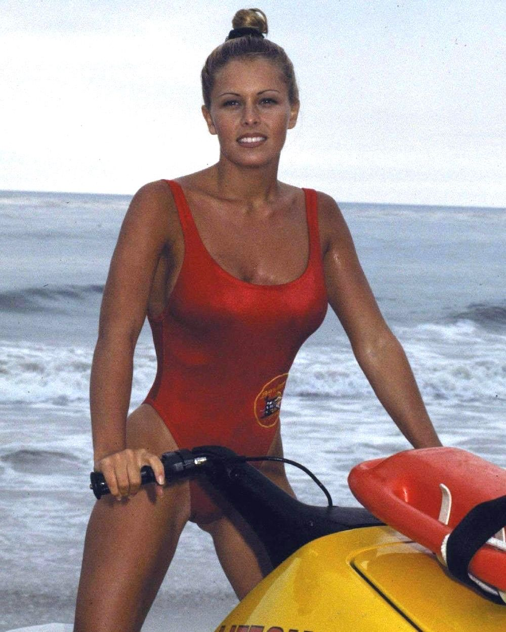 Nicole Eggert as Summer Quinn in Baywatch, jet ski