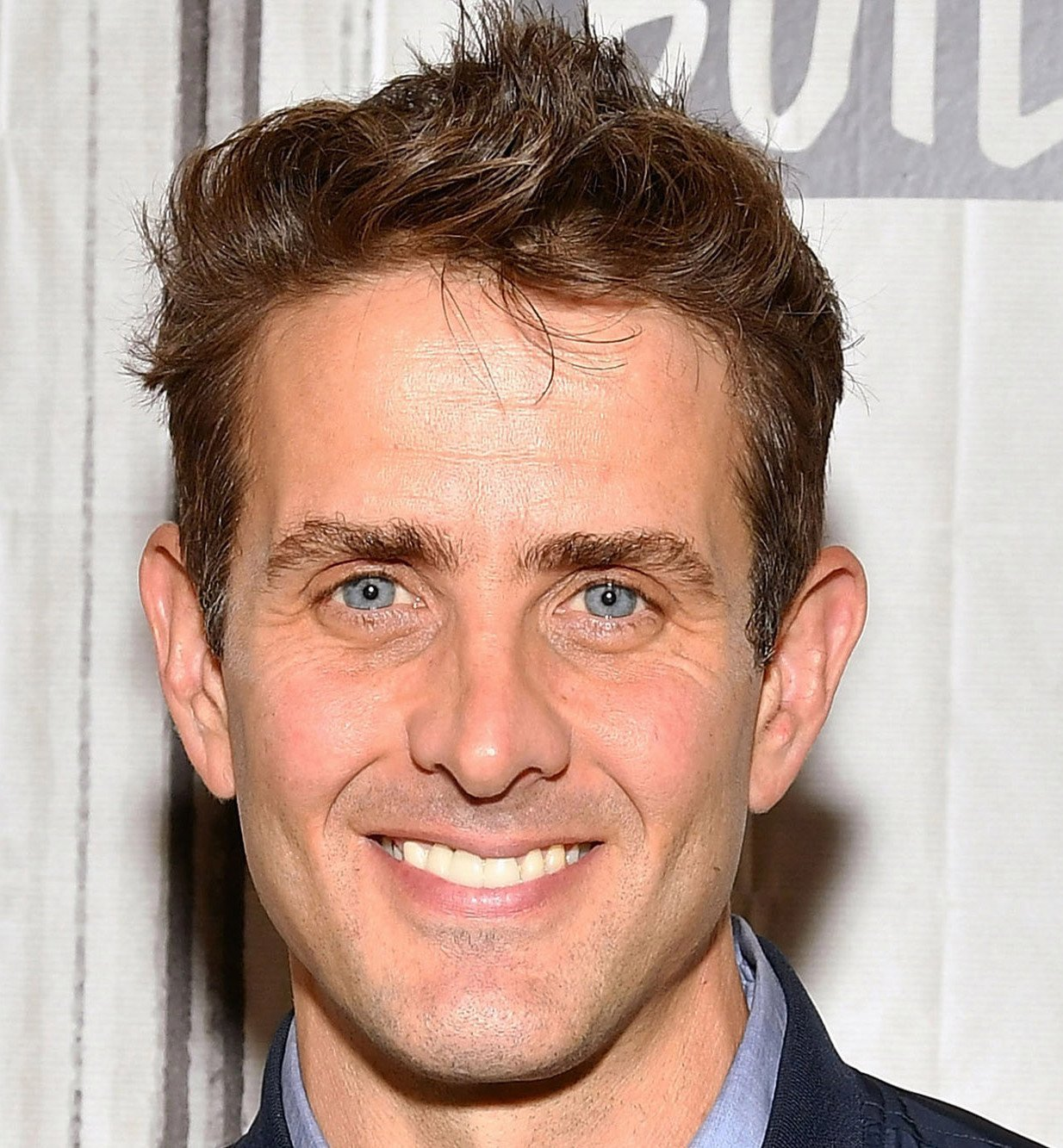 Joey McIntyre smiling for the camera in 2019