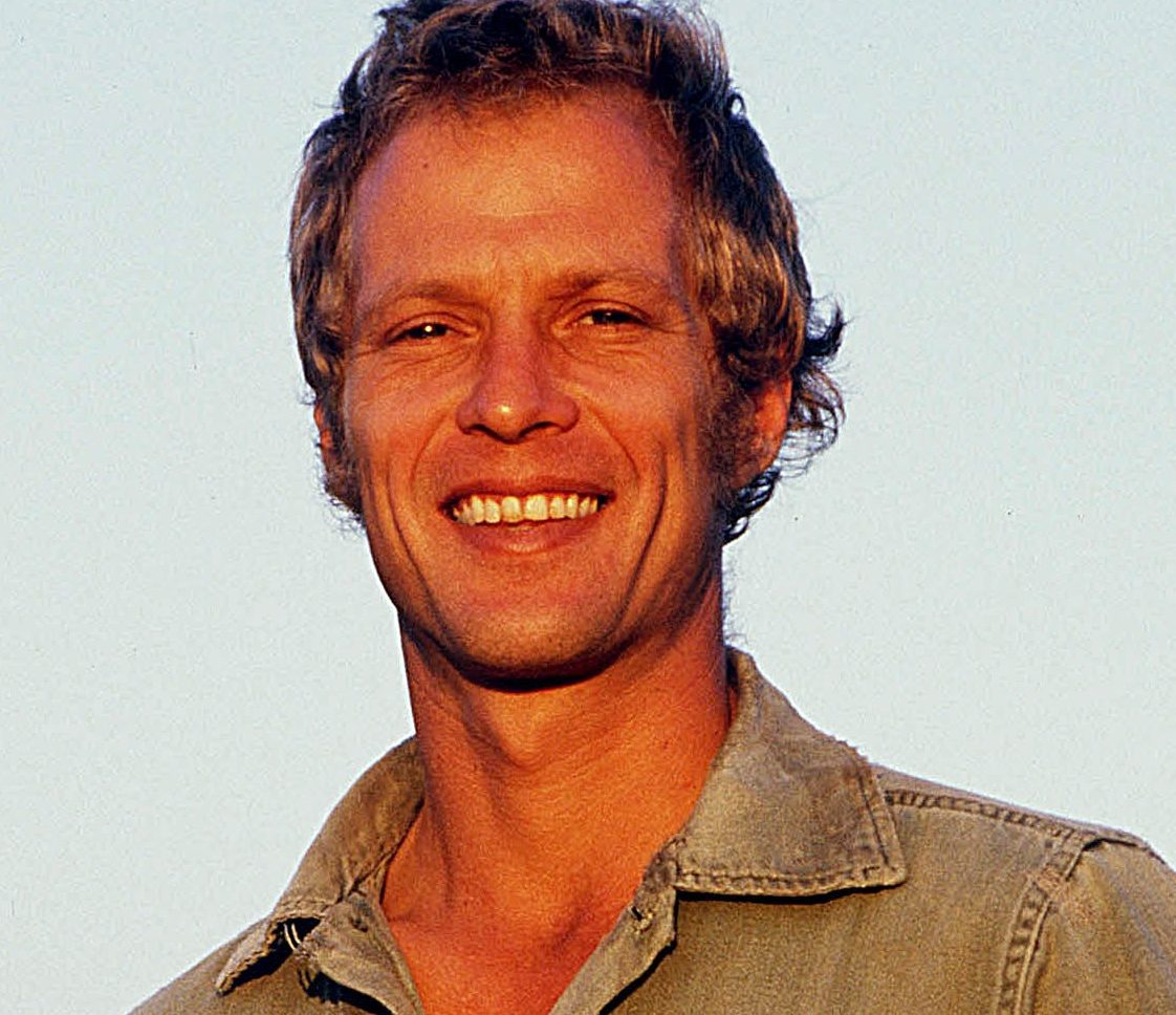 Ansell smiling e1603452050594 Is Paul Hogan Anything Like Crocodile Dundee In Real Life?