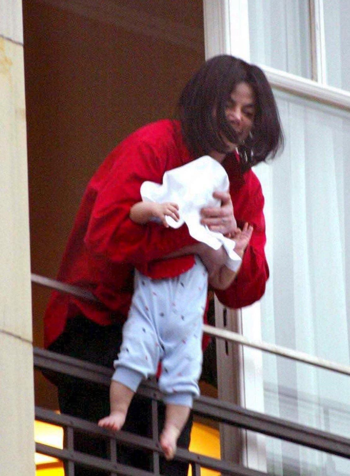 Michael Jackon dangles baby 20 Things You Didn't Know About Michael Jackson