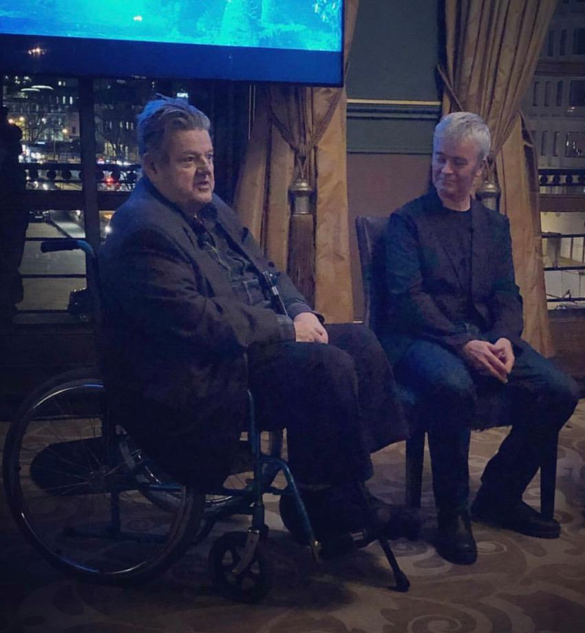 Robbie Coltrane in a wheelchair at a press event for Hagrid's Magical Creatures Motorbike ride, 2019