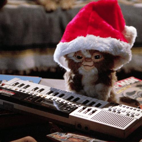 Mogwai wearing a Santa hat, playing keyboard in Gremlins (1984)