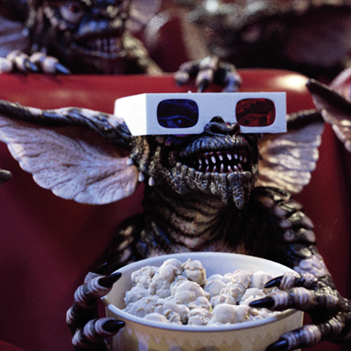 Gremlins eating pocorn, watching 3D movie with glasses in cinema