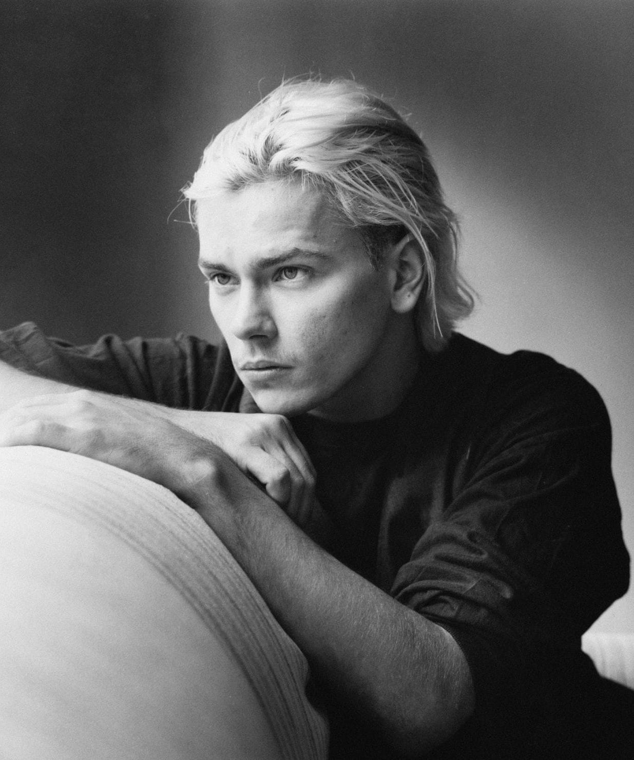 River Phoenix modelling for a black and white photoshoot