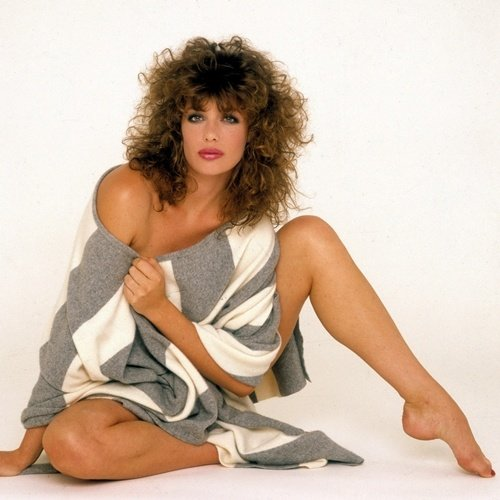 Kelly LeBrock modelling a loose jumper and 1980s perm