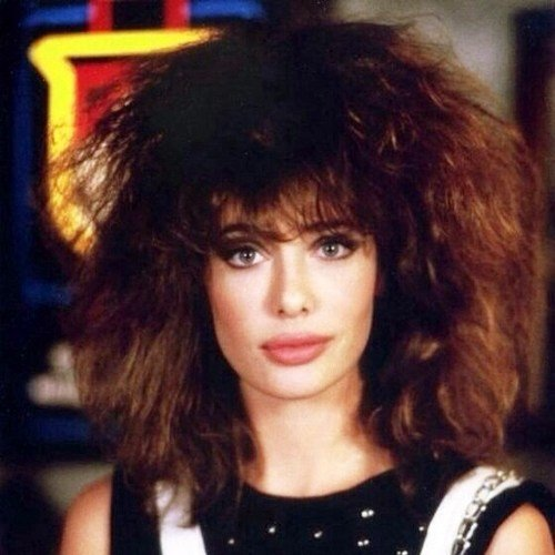 Kelly LeBrock rocking a 1980s perm