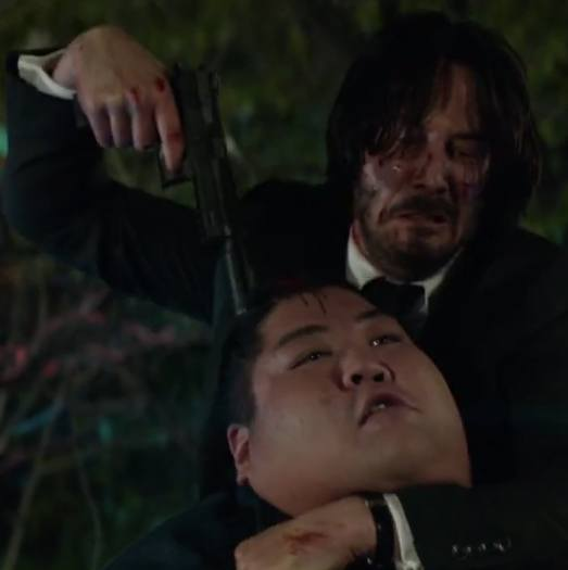 johnwick2 gunpoint headlock sumoman 10 Things You Didn't Know About The John Wick Films
