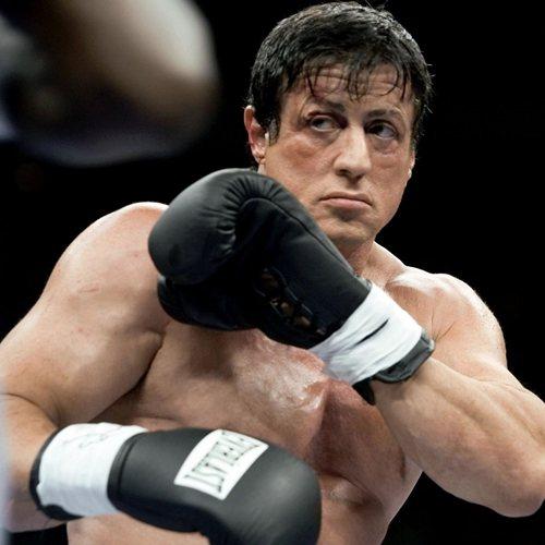 Sylvester Stallone as Rocky boxing