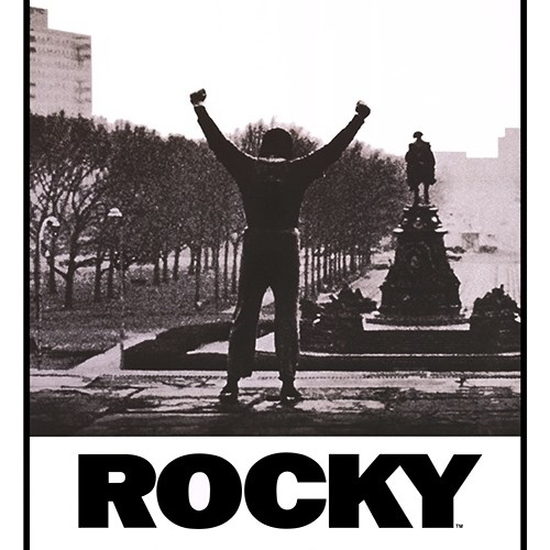 The poster/cover for Rocky with Sylvester Stallone raising his hands in the air opposite a statue in a park