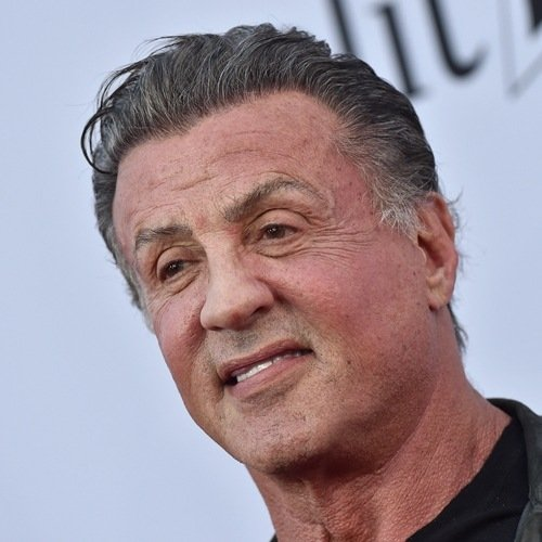 Sylvester Stallone showing his paralysed face on the left side