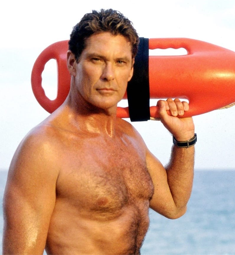 David Hasselhoff topless by the sea as Mitch Buchannon in Baywatch