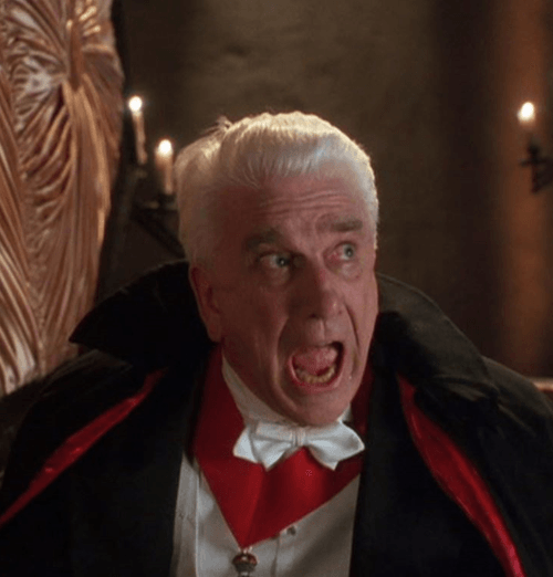 Leslie Nielsen as Count Dracula in Dracula: Dead and Loving It, 1995