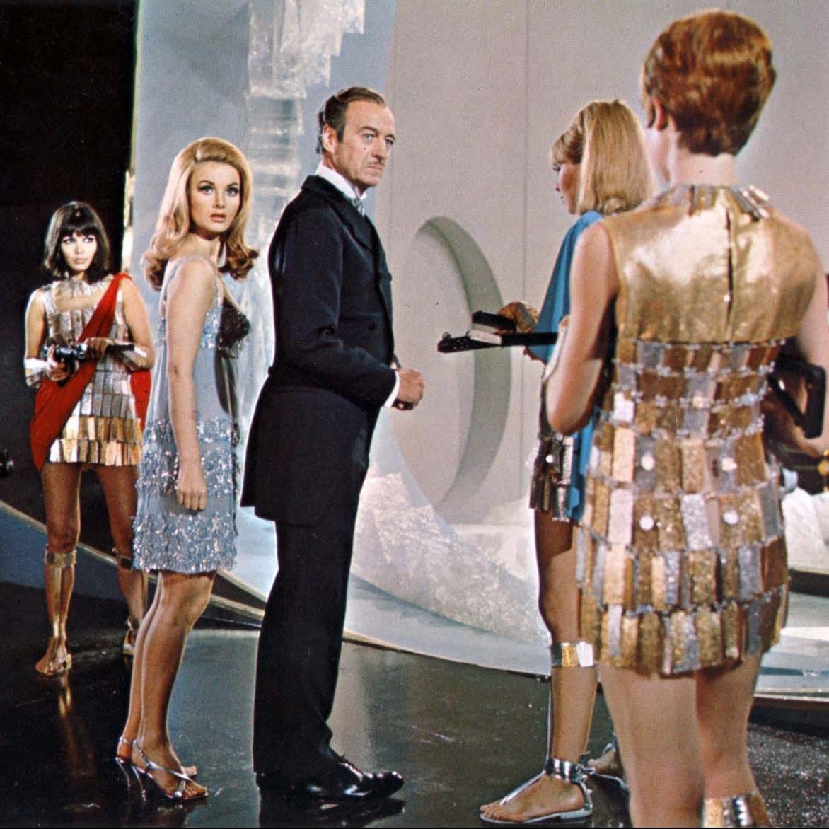 David Niven Barbara Bouchet Casino Royale e1572274859120 20 Groovy Truths You Probably Never Realized About Austin Powers: International Man Of Mystery!