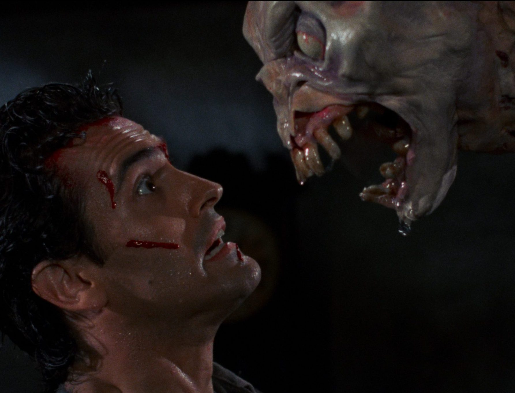 EVIL DEAD 2 t00.mkv snapshot 01.13.06 2018.12.16 14.16.39 scaled e1617264349546 20 Horror Movies That Defined The 1980s